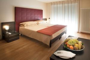 Letto o letti in una camera di Residence Calissano