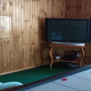 Телевизор и/или развлекательный центр в Гостевой дом Адель
