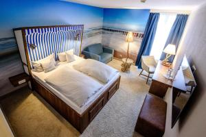 A bed or beds in a room at Dorint Hotel Alzey/Worms