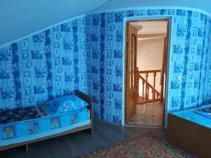 Кровать или кровати в номере Уютный Двор Зои Николаевны
