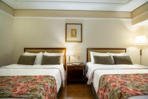 A bed or beds in a room at Royal Palm Plaza Resort