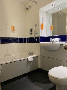 A bathroom at Days Inn Michaelwood M5