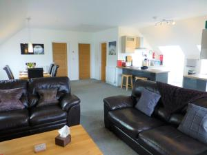 A seating area at Gerycastell Luxury Holiday Apartment with Stunning Views & EV Station Point