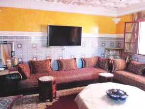 A seating area at Nice Holiday Traditional Apartment Marrakech