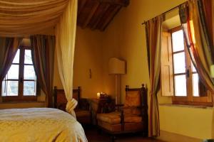 Letto o letti in una camera di Centro Ippico Della Berardenga