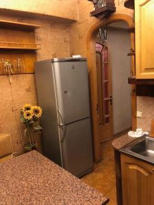 A kitchen or kitchenette at Baumana_Apartments