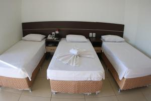 A bed or beds in a room at Bella Vista Park Hotel