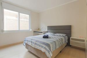 A bed or beds in a room at O melhor apartamento em frente ao Parcão