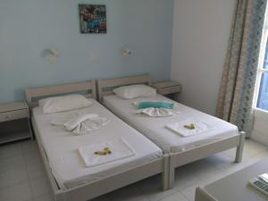 A bed or beds in a room at Studios Iris