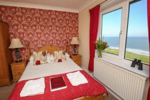 A bed or beds in a room at The Seacliffe - Whitby