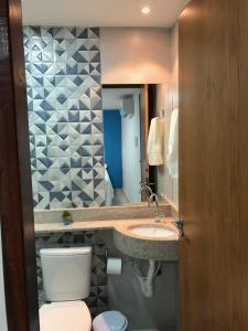 A bathroom at POUSADA MARITIMAR