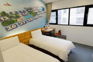A bed or beds in a room at Sunshine Ximen
