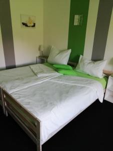 Ein Bett oder Betten in einem Zimmer der Unterkunft Buntes Moor