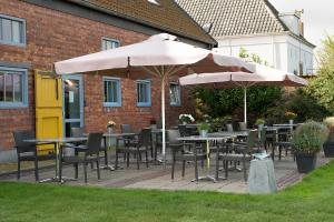 A restaurant or other place to eat at Hoevehotel 'Hof Christina'
