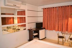 A television and/or entertainment centre at Motel Astral