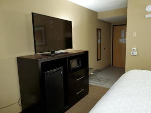 A television and/or entertainment center at Best Western Harrisburg North Hotel