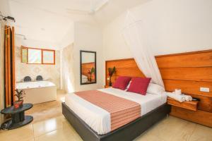 Cama o camas de una habitación en Manigua Tayrona Hostel