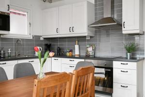 A kitchen or kitchenette at Modern family home in Stockholm Kista - master bedroom and loft bedroom