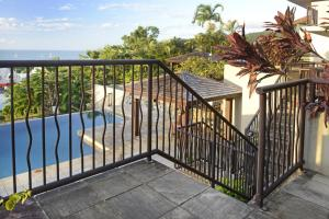 A view of the pool at Ocean Views - Airlie Beach or nearby