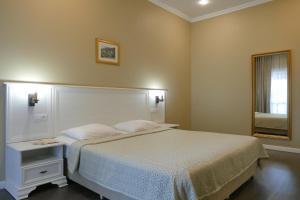 Кровать или кровати в номере Отель Абаата