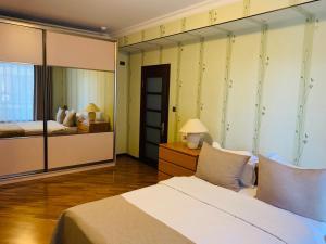 Cama ou camas em um quarto em Promenade 2 BDR Apartment