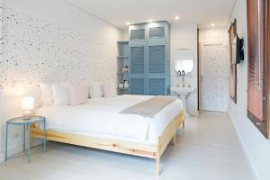A bed or beds in a room at Casa Legado