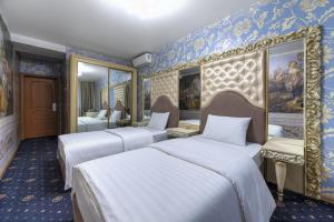 A bed or beds in a room at Gallery Voyage Hotel