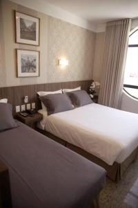Cama ou camas em um quarto em Nohotel Premium Americana
