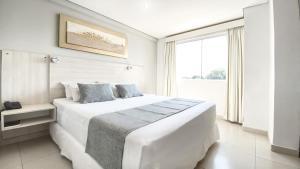 Кровать или кровати в номере Danieri Asunción Hotel