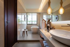 A bathroom at INAYA Putri Bali
