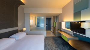 ラディソン ブル ホテル&レジデンス マプトにあるテレビまたはエンターテインメントセンター