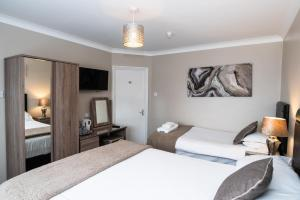 A bed or beds in a room at The Causeway Guest House