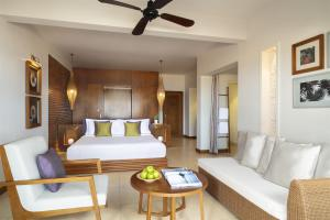 A bed or beds in a room at Avani Quy Nhon Resort