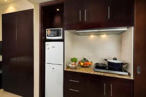 A kitchen or kitchenette at Millennium Central Al Mafraq