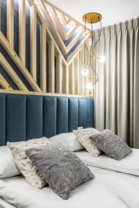 A bed or beds in a room at Rezydencja Zakopiańska