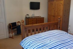 A bed or beds in a room at Moorehouse Farm