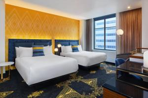 A bed or beds in a room at W Minneapolis - The Foshay