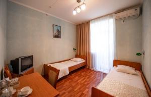 Кровать или кровати в номере Pansionat Dacha Beketova