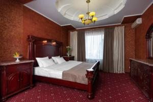 Кровать или кровати в номере Отель Бридж