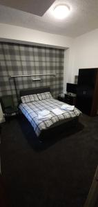 A bed or beds in a room at The Lodge Guest Accommodation
