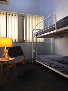 A bunk bed or bunk beds in a room at Banana Bender Backpackers