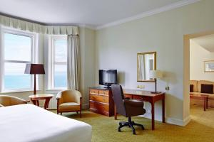 A television and/or entertainment centre at Bournemouth Highcliff Marriott Hotel