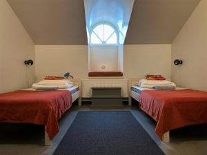 A bed or beds in a room at Hostel Suomenlinna