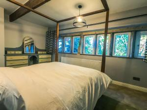 A bed or beds in a room at Luxury traditional stone farmhouse, stunning views
