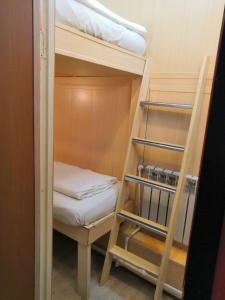 A bunk bed or bunk beds in a room at Art Galaktika Hotel