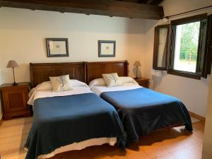 Cama o camas de una habitación en Apartamentos Buga