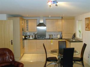 A kitchen or kitchenette at Short Term Worsley Apartment