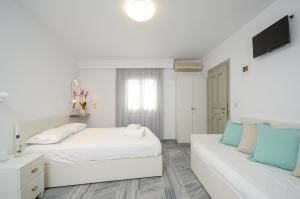 A bed or beds in a room at Soula Hotel