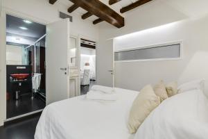 Un ou plusieurs lits dans un hébergement de l'établissement Colonna Suite Luxury - Pantheon