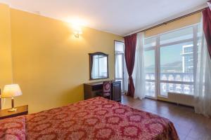 Кровать или кровати в номере Отель Оазис